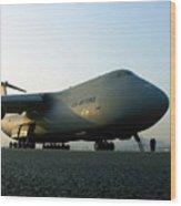 A C-5 Galaxy Sits On The Flightline Wood Print