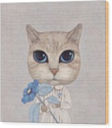 A Cat With A Blue Flower Wood Print