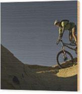 A Caucasian Man Mountain Biking Wood Print by Bobby Model