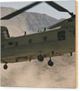 A Ch-47 Chinook Helicopter Kicks Wood Print