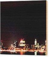 A City's Lights Wood Print by Richard Gerken
