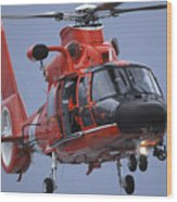A Coast Guard Mh-65 Dolphin Helicopter Wood Print by Stocktrek Images