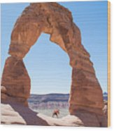 A Couple Kissing Under Delicate Arch In  The Arches National Par Wood Print