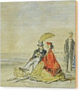 A Couple Seated And A Couple Walking On The Beach Wood Print