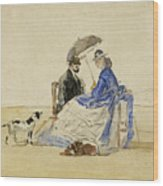 A Couple Seated On The Beach With Two Dogs Wood Print