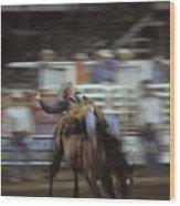 A Cowboy Rides A Bucking Bronco Wood Print