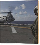 A Crew Chief Watches A Ch-46e Sea Wood Print