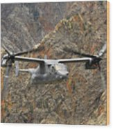 A Cv-22 Osprey Flies Over The Canyons Wood Print by Stocktrek Images