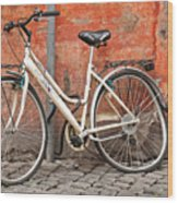 A Dejected Bicycle Waits Patiently On A Cobbled Street In Rome. Wood Print