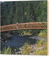 A Hiker Crosses A Bridge Wood Print