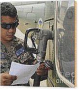 A Honduran Crew Chief Consults Wood Print