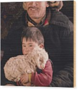 A Kazakh Eagle Hunter And His Son Wood Print