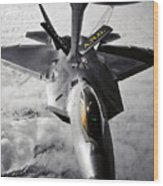 A Kc-135 Stratotanker Refuels A F-22 Wood Print