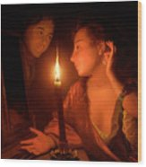 A Lady Admiring An Earring By Candlelight Wood Print