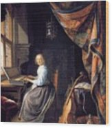 A Lady Playing The Clavichord Wood Print