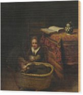 A Little Girl Rocking A Cradle Wood Print