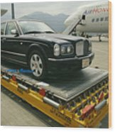 A Luxury Bentley Unloaded From An Wood Print by Justin Guariglia