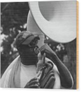 A Man Blows His Horn Wood Print