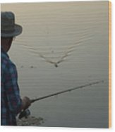 A Man Fishes For Largemouth Bass Wood Print