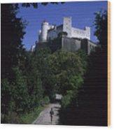 A Man Walks Toward The Salzburg Castle Wood Print by Taylor S. Kennedy