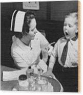 A Nurse Examining The Teeth Of A Boy Wood Print by Everett