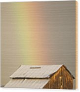 A Rainbow Arches From The Sky Onto Wood Print
