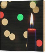 A Red Christmas Candle With Blurred Lights Wood Print