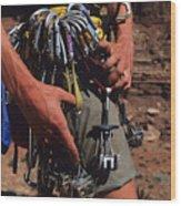 A Rock Climber Check Her Gear Wood Print by Bill Hatcher
