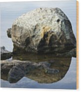 A Rock In Still Water Wood Print