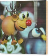 A Rudolph The Red Nosed Reindeer Ornament With A Penguin Wood Print