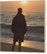 A Silhouetted Figure Enjoys The Ocean Wood Print