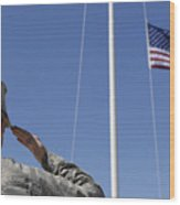 A Soldier Salutes The American Flag Wood Print