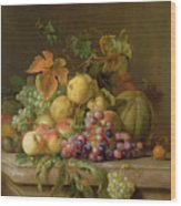 A Still Life Of Melons Grapes And Peaches On A Ledge Wood Print by Jakob Bogdani