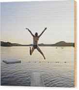 A Swimmer Jumps Off A Diving Board Wood Print
