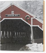 A Traditional Covered Bridge On A Snowy Wood Print