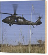 A U.s. Army Uh-60 Black Hawk Helicopter Wood Print by Stocktrek Images