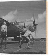 A Us Navy Fighter Pilot Gets The Take Off Flag From The Deck Crew Of An Aircraft Carrier Wood Print