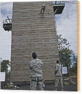 A U.s. Soldier Rappels Down A 40-foot Wood Print