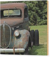 A Vintage Truck On A Yard Wood Print