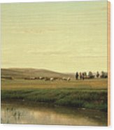A Wagon Train On The Plains Wood Print
