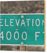 A Weathered Elevation Sign On Highway Wood Print