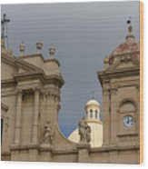 A Well Placed Ray Of Sunshine - Noto Cathedral Saint Nicholas Of Myra Against A Cloudy Sky Wood Print