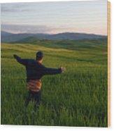 A Young Boy Runs Through A Field Wood Print