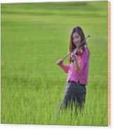 A Young Girl In A Folk Costume Plays A Vivaro In A Green Rice Fi Wood Print