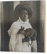 A Young Kenyan Woman Holds Her Pet Deer Wood Print by Underwood And Underwood