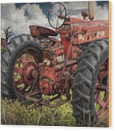 Abandoned Old Farmall Tractor In A Grassy Field Wood Print