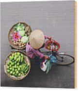 Aerial View Of A Vietnamese Traditional Seller On The Bicycle With Bags Full Of Vegetables Wood Print
