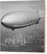 Airship Flying Over New York City Wood Print