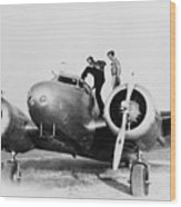Amelia Earhart Stanind On The Wing Wood Print by Everett