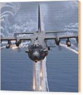 An Ac-130h Gunship Aircraft Jettisons Wood Print